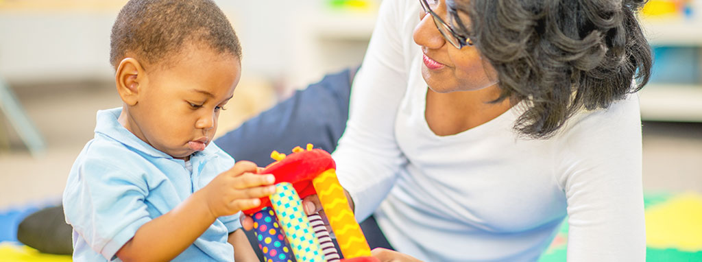 Liberty Post NY Early Intervention Program, mother and son playing with toy
