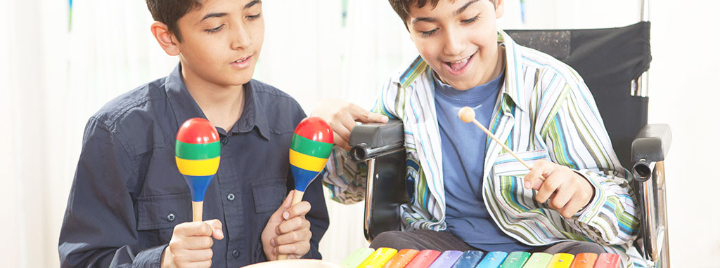 Music Therapy at Liberty POST | Two boys playing maracas and xylophone